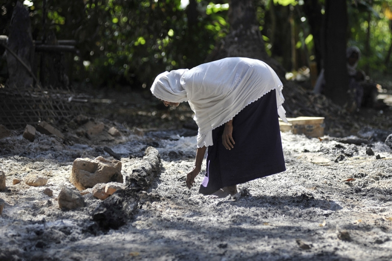 <p>A Muslim woman collects pieces of metal from the rubble of Muslim quarter of Pa Rein village in Myauk Oo township, which was burned in recent violence between Buddhist Rakhines and Muslim Rohingyas on October 29, 2012 in Rakhine state, Myanmar.</p>
