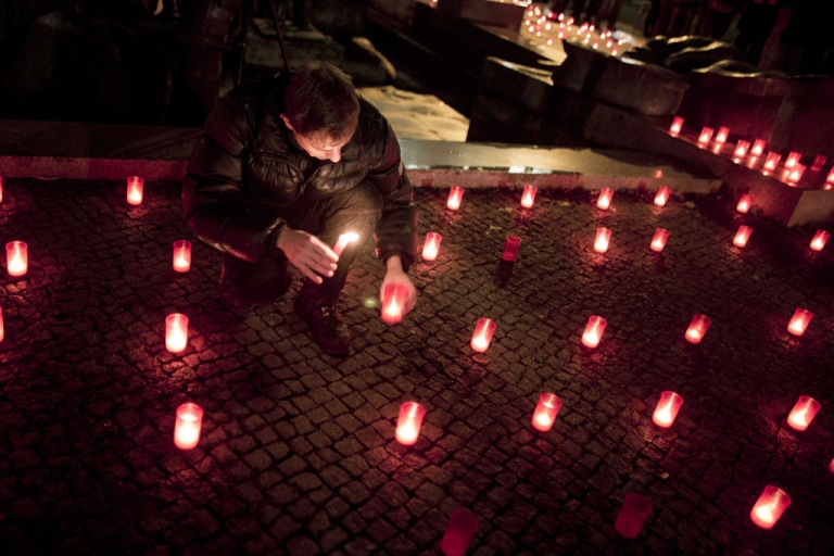 <p>A member of the Berlin gay community lights candles after a march to mark World AIDS Day on November 30, 2012 in Berlin, Germany. Cities across the world are marking World AIDS Day, which officially takes place on December 1, with a variety of events.</p>
