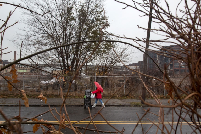 <p>Scenes of the partially torn down Remington Arms factory with cemetery workers cleaning up the St. Augustine Cemetery in East Bridgeport, CT on November 27, 2012.</p>