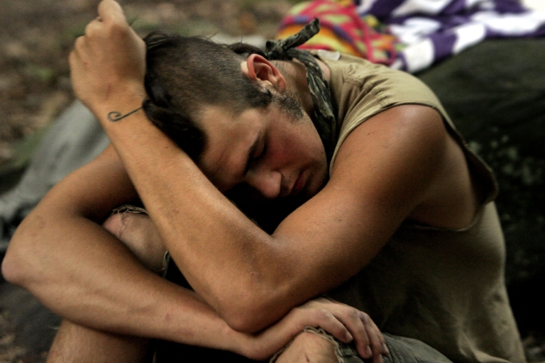 <p>A student rests while camping out at the Center for Attention and Related Disorders? (C.A.R.D.) camp at the Great Hollow Wilderness School July 30, 2003 in New Fairfield, Connecticut.</p>