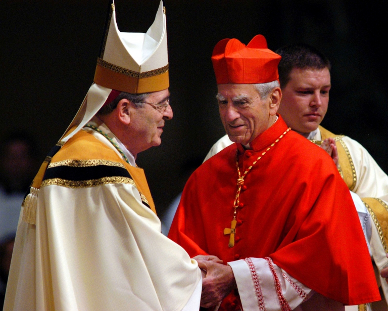 <p>Newly installed Archbishop of Philadelphia Justin Rigali (L) is greeted by Cardinal Anthony Bevilacqua, Archbishop Emeritus of Philadelphia, during the installation ceremony October 7, 2003 in Philadelphia, Pennsylvania.</p>