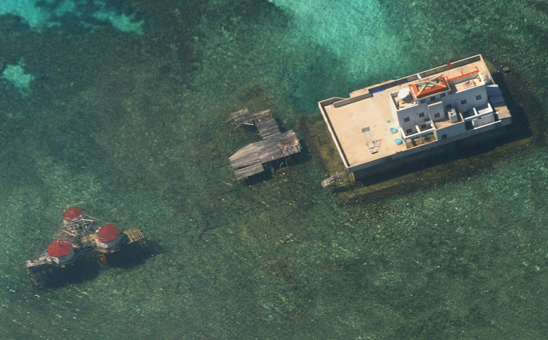 <p>An aerial photograph taken from a Philippine Air Force aircraft shows Chinese built structures on the Mischief Reef in the disputed Spratly islands, located in the South China Sea.</p>