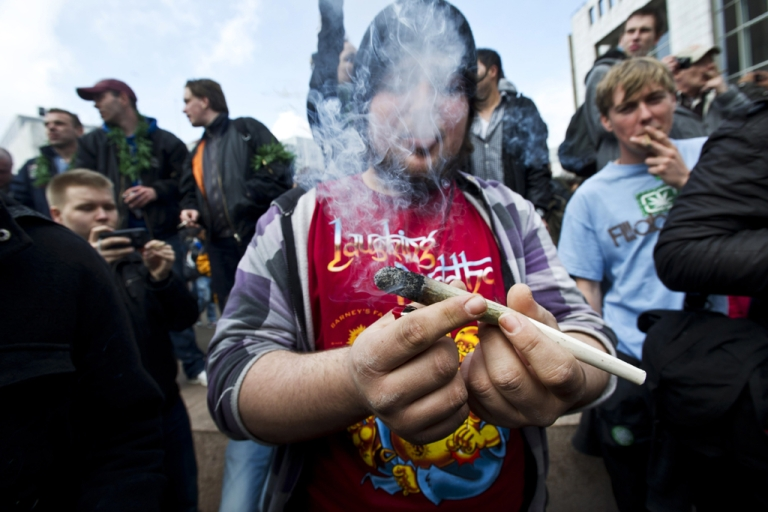 <p>Protesters smoke marijuana during a demonstration against new government legislation calling for the creation of a
