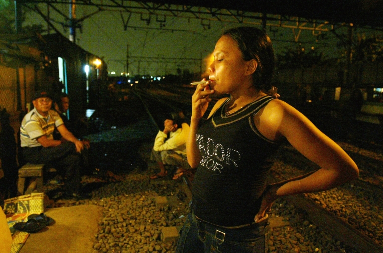 <p>Indonesian slum dwellers, living by the train tracks nearby where rooms are rented for only 75 cents for sex July 10, 2004 in Jakarta, Indonesia.</p>