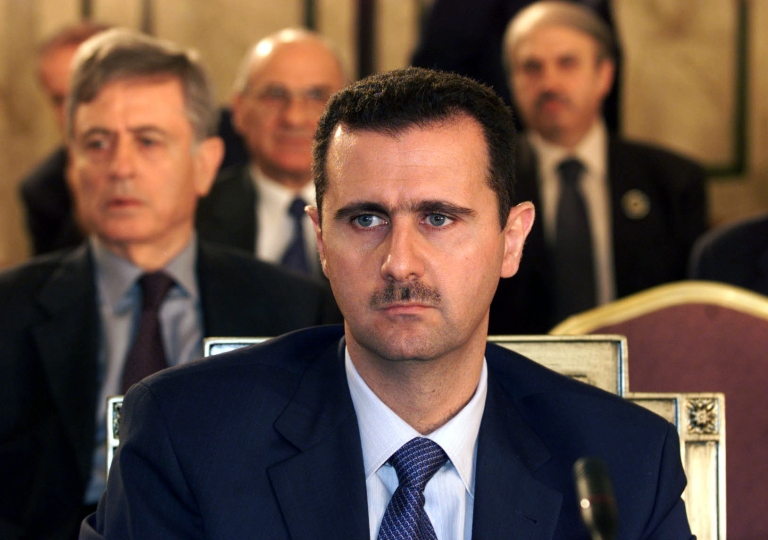 <p>Syrian President Bashar al-Assad attends the closing session of the Arab summit in Beirut on March 28, 2002.</p>