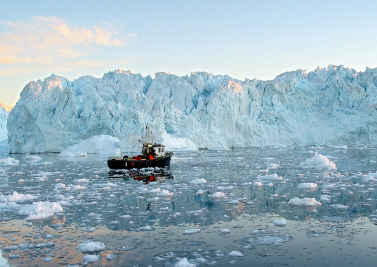 <p>A fishing boat cruises in the Ilulissat fjord, on Greenland's western coast.</p>