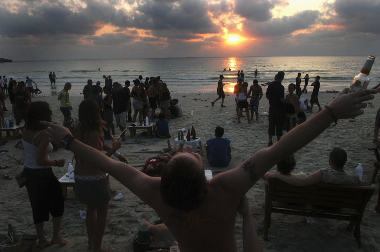 <p>Revelers continue to dance as the sun rises over Sunrise Beach in Haadrian, Koh Phangan.</p>