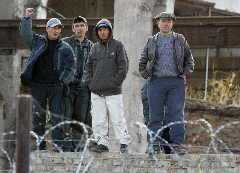 <p>Prisoners of the penal colony No. 8 in the village of Petrovka, some 45 kms from the capital Bishkek, wave to photographers.</p>