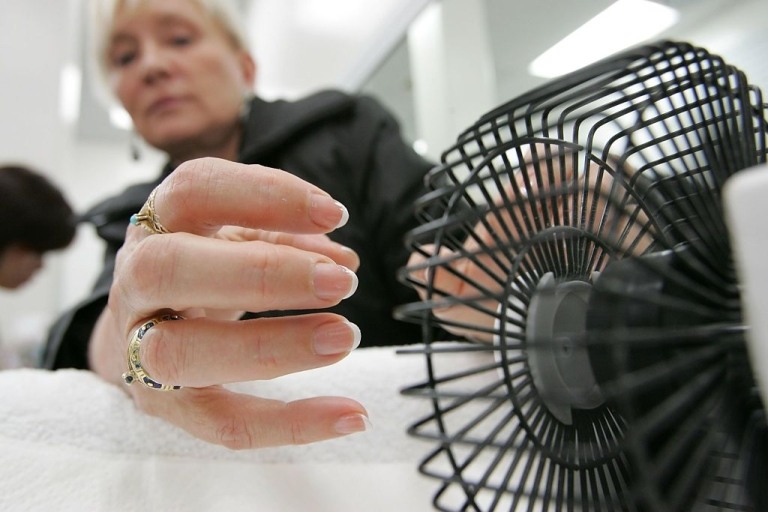 <p>SAN FRANCISCO - MARCH 03: Linda Donly-Reid, a customer at JT Nails, uses a small fan to dry her nails after receiving a manicure March 3, 2006 in San Francisco. California Assembly Speaker pro Tem Leland Yee (D-San Francisco) has renewed calls to pass new legislation to clean up unsanitary nail salons after a woman in Fort Worth, Texas died as a result of a staph infection caused by bacteria from a nail salon.</p>