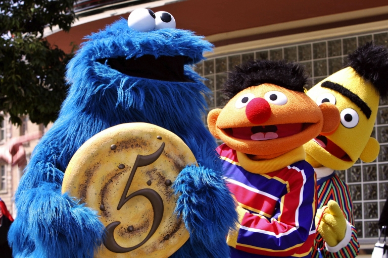 <p>Sesame Street characters Cookie Monster, Ernie (center) and Bert (behind) at the fifth anniversary of Hollywood theme park Universal Studios Japan in Osaka.</p>