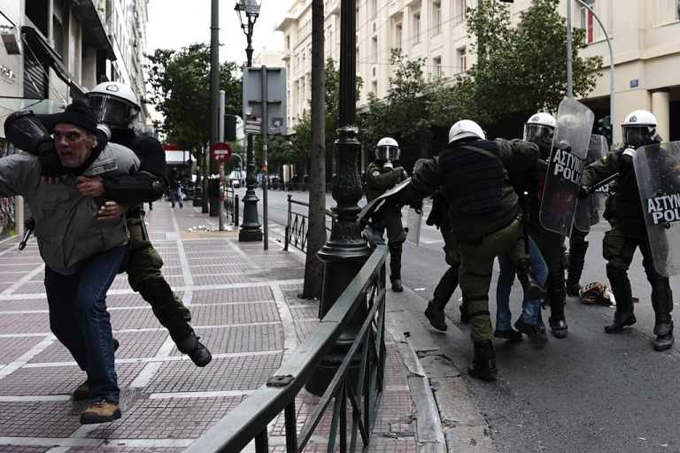 <p>Protesters clash with riot police in Athens on Feb. 10.</p>