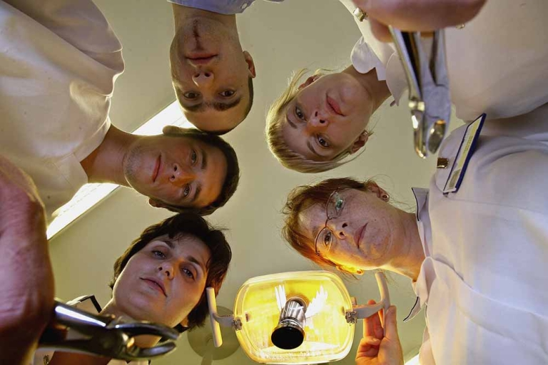 <p>Polish salaried dentists gather round a surgery chair at Lochmaben hospital June 12, 2006, Lochmaben in Scotland.</p>