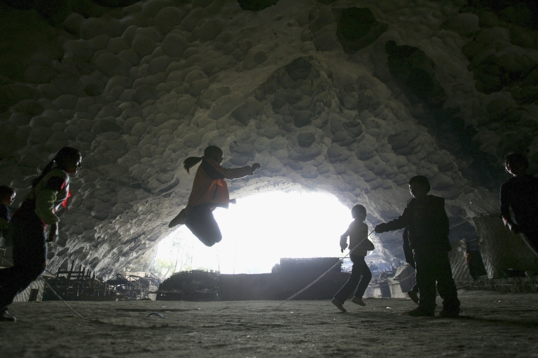 <p>Chinese children play rope-skipping at the playground of a school in a huge cave at a remote Miao village on March 16, 2007 in Ziyun county, Guizhou province of southwest China.</p>