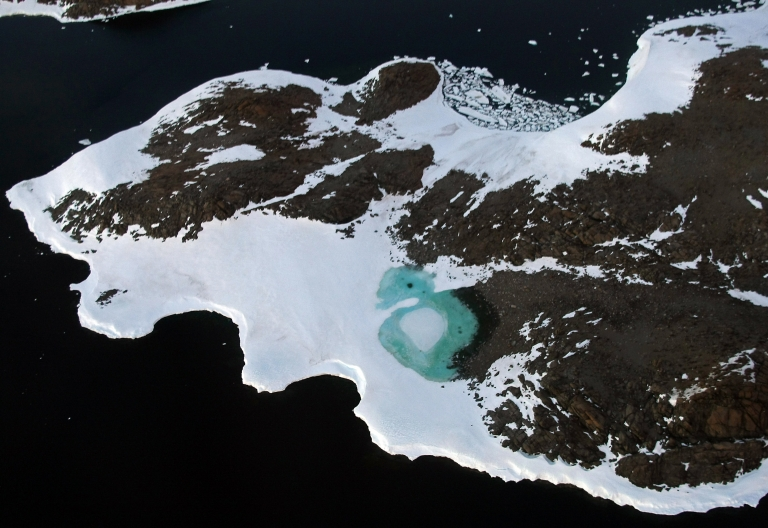 <p>A less ancient Antarctic lake forms from melting snow near Cape Folger on the Budd Coast in the Australian Antarctic Territory on January 11, 2008.</p>