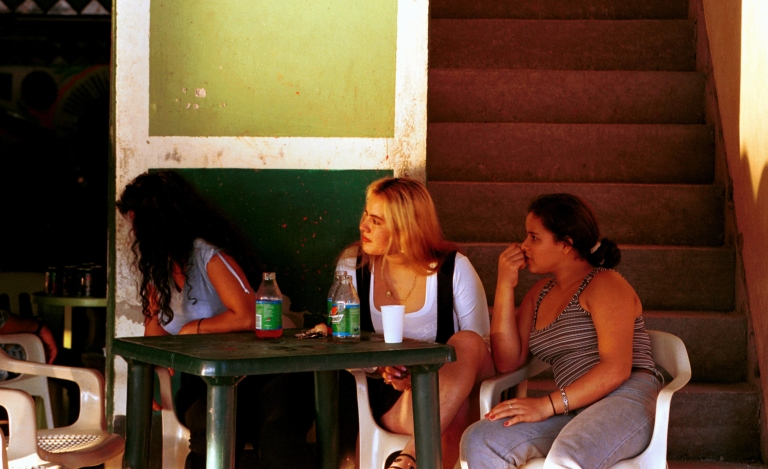 <p>Prostitutes sit at an outdoor table February 21, 2001 in Peas Coloradas, Colombia.</p>