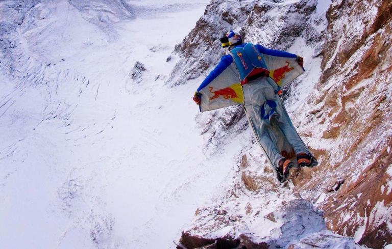 <p>Russian extreme sport star Valery Rozov jumps off Europe's highest mountain, Mount Elbrus, wearing a wing-suit , on September 10, 2008 near Mineralnye Vody, Russia.</p>