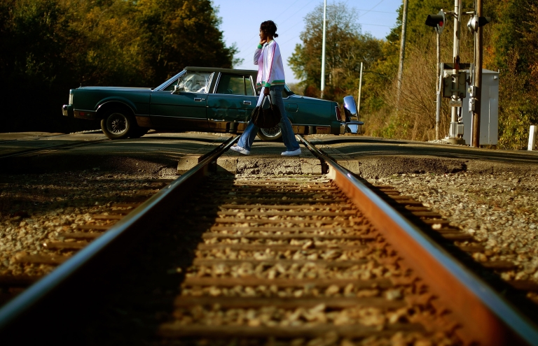<p>A woman crosses to the other side of the tracks November 4, 2008 in Birmingham, Alabama.</p>