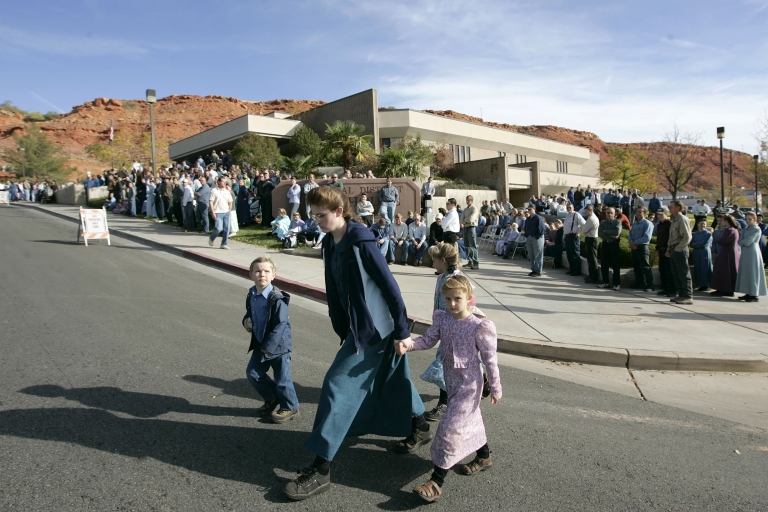 <p>Polygamists from Colorado City, Arizona, gather Nov. 14, 2008 in St. George, Utah to protest the sale of land from the FLDS Trust by the state of Utah. FLDS head Warren Jeffs was sentenced to life in prison Tuesday for sexually assaulting two girls.</p>