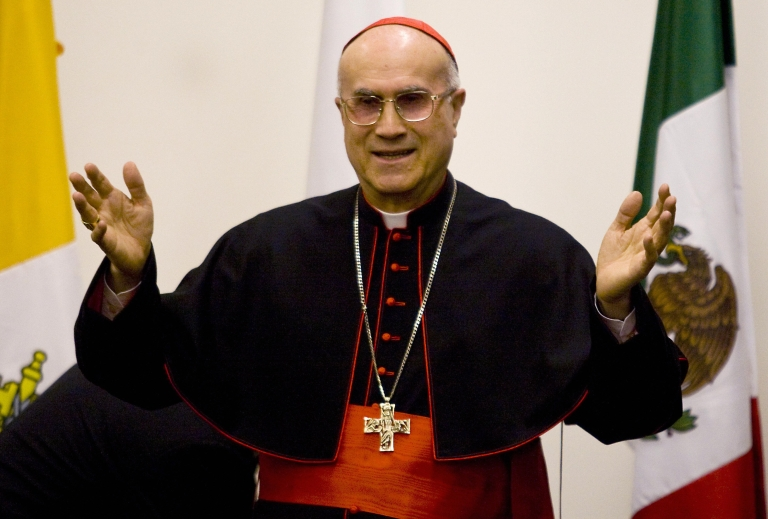 <p>Secretary of State Cardinal Tarcisio Bertone (above) has said that the media is to blame for