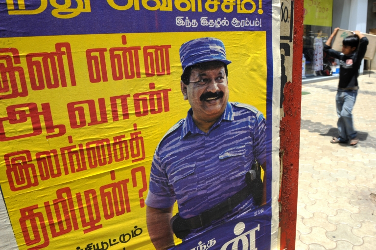 <p>A poster of slain Liberation Tigers of Tamil Eelam (LTTE) leader Velupillai Prabhakaran is seen in Mumbai on May 26, 2009.</p>