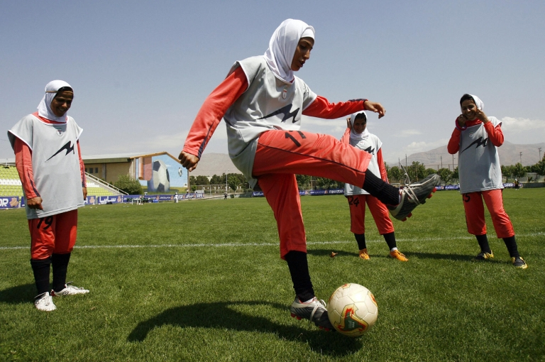 <p>Iran has now banned women from public viewing events of the Euro 2012 soccer tournament. Here, players of Iran's women national football team warm-up before their friendly football match with club Malavan Anzali women's team in Tehran on June 25, 2009</p>