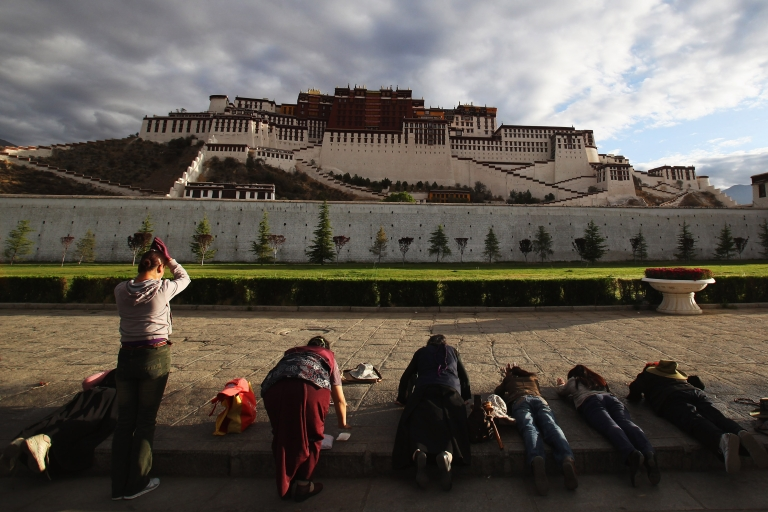 <p>Tibetan pilgrims prostrate themselves in front of the Potala Palace on June 21, 2009 in Lhasa, Tibet Autonomous Region, China.</p>