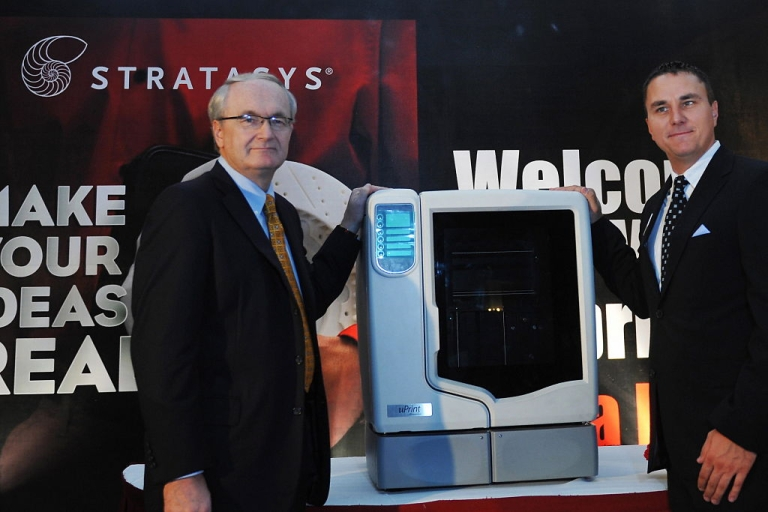 <p>Product Marketing Manager of Stratasys Inc, Fred Fischer (R) and Vice President International Sales, Woody Frost stand next to the newly launched U-print 3D printer in Bangalore on July 30, 2009. Design Tech Systems, the sole country-wide distributor of Stratasys, organised the conference to launch U-Print, a personal 3D printer from their dimension series in India.</p>