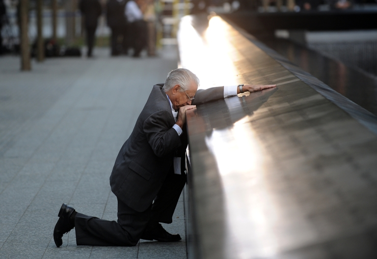 <p>Robert Peraza, who lost his son Robert David Peraza, pauses at his son's name at the North Pool of the 9/11 Memorial during the 10th anniversary ceremonies at the site of the World Trade Center on Sept. 11, 2011.</p>