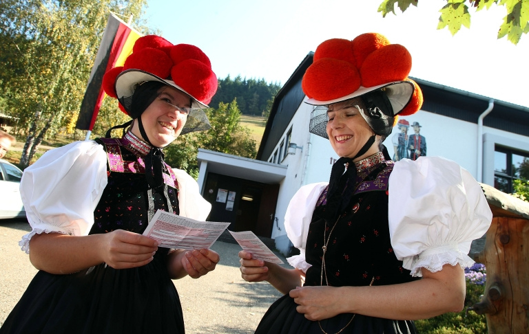 <p>Claudia Lutz (L) and Christiane Huber of the Kirnbacher Kurrende Black Forest costume club cast their votes for the German federal elections on September 27, 2009 in Germany.</p>