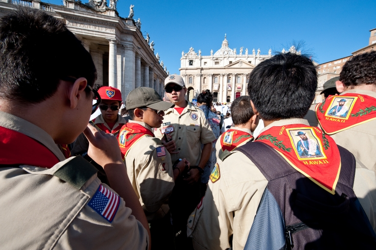 <p>Catholic faithful, including US Boy Scouts gathered in St. Peters's square at the Vatican, on October 11, 2009, as Pope Benedict XVI prepares to canonise five new saints, including a man who dedicated his life to lepers in Hawaii and another considered one of the greatest mystics of the 20th century.</p>