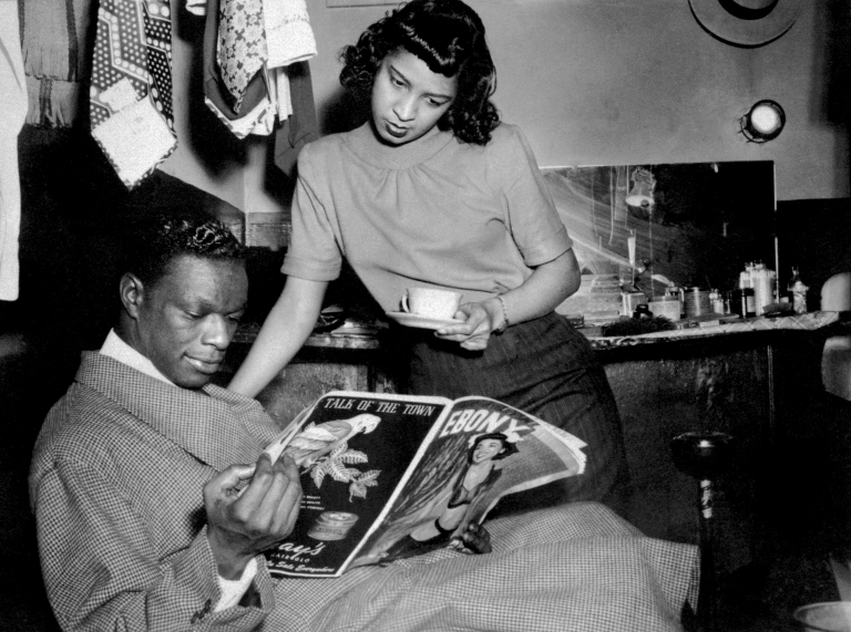 <p>Jazz singer and piano player Nat King Cole relaxes with wife Maria in his box at the Apollo Theatre, in Harlem, in New York in the '50s.</p>