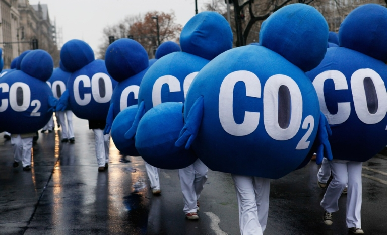 <p>Environmental activists dressed up as CO2 molecules stage a protest in Berlin on Dec. 12, 2009, to coincide with the United Nations Climate Change Conference in Copenhagen.</p>