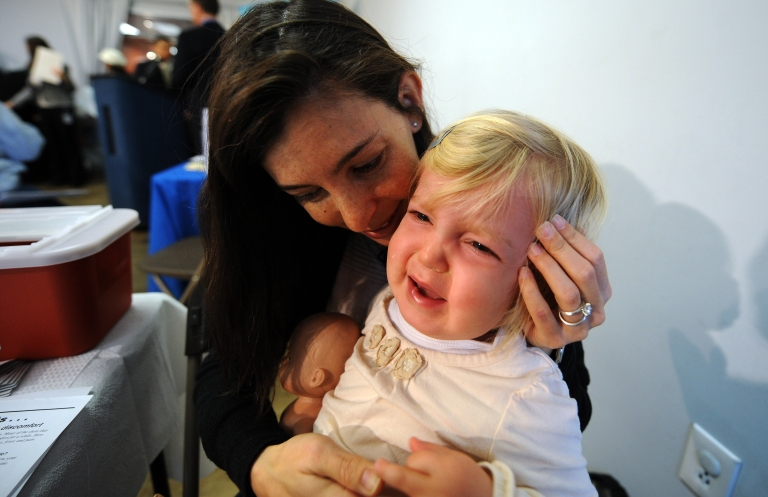 <p>Two year-old Claire Davis has her swine flu vaccination injected at a community clinic in Washington, DC, on January 13, 2010.</p>