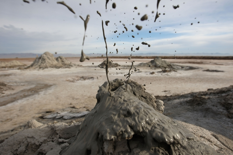 <p>Carbon dioxide gas from deep underground fissures bubbles up through geothermal mudpots, or mud volcanoes, over the San Andreas earthquake fault near the Salton Sea National Wildlife Refuge on Jan. 16, 2010, near Calipatria, California. President Obama in 2013 issued a proposed rule under the Clean Air Act to regulate CO2 from power plants.</p>