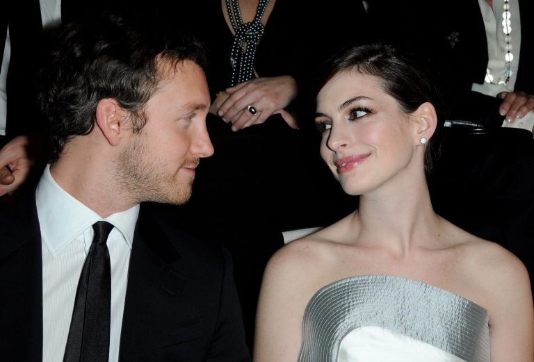 <p>Actor Adam Schulman and Actress Anne Hathaway (R) attend Giorgio Armani Prive Fashion Show during Paris Fashion Week Haute Couture S/S 2010 at Palais de Chaillot on January 25, 2010 in Paris, France.</p>