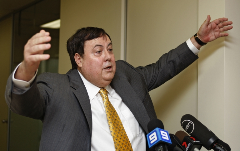 <p>Up in arms — mining magnate Clive Palmer gestures during a press conference in Perth, Australia.</p>