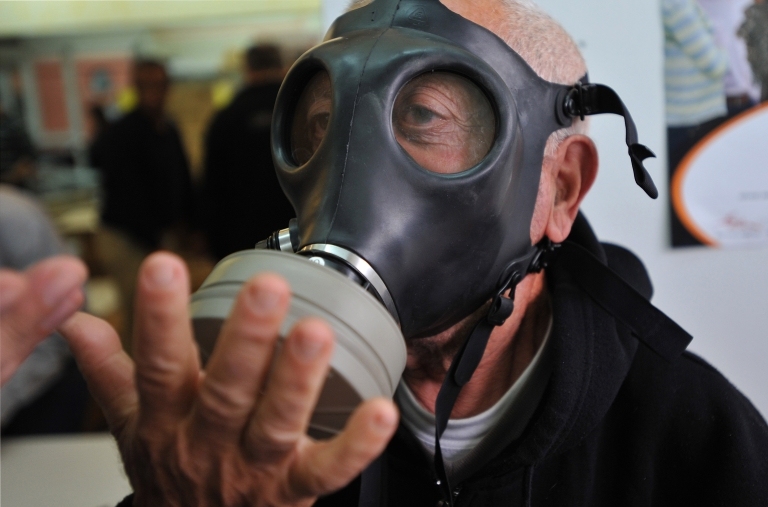 <p>An Israeli man tries a gas mask at a distribution centre in Or-Yehuda, south of Tel Aviv on February 28, 2010. Israel began distributing new gas masks for use in a possible chemical or biological attack, the army said.</p>