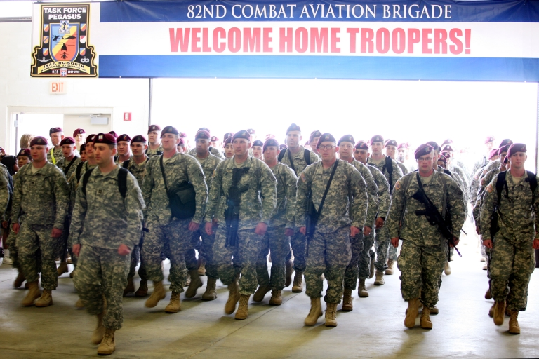 <p>Troops from the 82nd Combat Aviation Brigade, 82nd Airborne Division, arrive a year-long deployment in Afghanistan, at Pope Air Force base March 16, 2010 in Fort Bragg, North Carolina.</p>