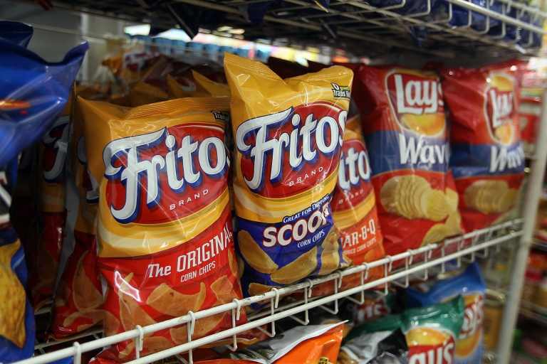 <p>Bags of chips manufactured by PepsiCo Frito-Lay brand are seen on a shelf on March 22, 2010 in Miami, Florida.</p>