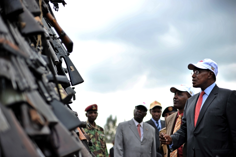 <p>Kenyan government minister George Saitoti (R) inspects a cache of illegal fire arms in Nairobi, March 24, 2010 before it is set abalaze as part of a campaign by the Kenyan government to mop-up illicit small arms and light weapons that are at the centre of increasing violent crime in Kenya and Africa.</p>