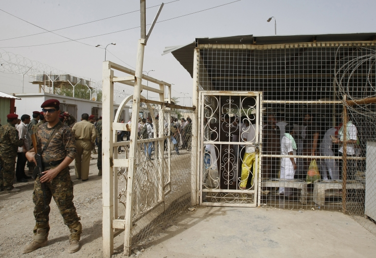 <p>An Iraqi soldier stands guard at a detention facility in Baghdad before the release on April 29, 2010 of about 120 prisoners, according to Iraqi officials.</p>