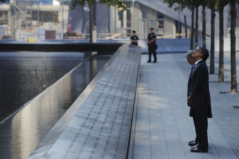<p>Former U.S. President George W. Bush and President Barack Obama visit the North Memorial Pond as they arrive for a commemoration ceremony on the 10th anniversary of the 9/11 attacks at the National September 11 Memorial, September 11, 2011 at Ground Zero in New York City. On September 12, 2011, the memorial opened to the public.</p>