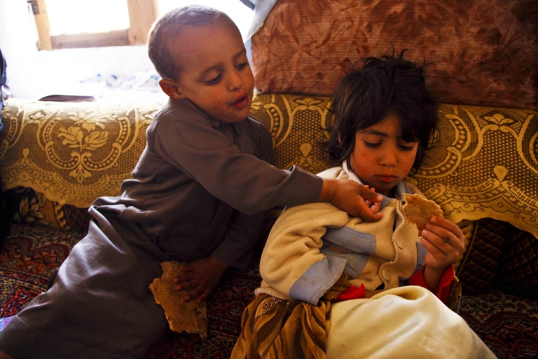 <p>Two Yemeni children share a piece of bread. Since the political crisis came to the boil at the beginning of the year, food prices have soared leaving many families struggling to feed their children this Ramadan, the Muslim holy month of fasting.</p>