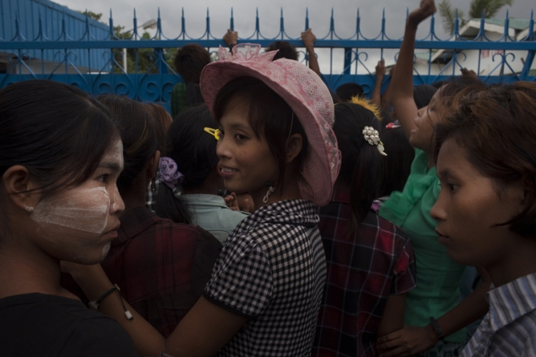 <p>In an industrial zone on the outskirts of Yangon, Myanmar, textile workers stage a strike for higher wages outside the South Korean-owned clothing factory where they work. The workers, who are mostly women aged 17-25, work twelve hour shifts, six days a week for little over $2 a day.</p>