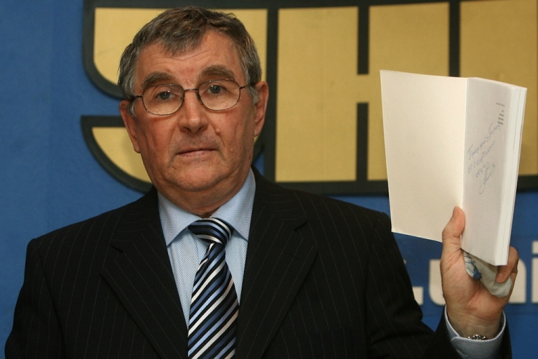 <p>in Kiev Dec. 21, 2006, Valter Litvinenko, father of late former Russian spy Alexander Litvinenko, displays a book about his son, who he now denounces.</p>