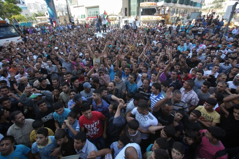 <p>Palestinians shout slogans during a protest against the high cost of living on Sept. 10, 2012 in the West Bank city of Hebron.</p>