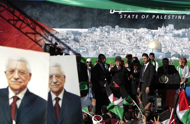 <p>Palestinian president Mahmud Abbas gestures as he arrives to addresses the crowds as Palestinians celebrate his successful bid to win U.N. statehood recognition in the West Bank city of Ramallah on December 2, 2012. Israel announced on Sunday that it was withholding millions of dollars in tax revenue from Palestine in protest against the vote.</p>