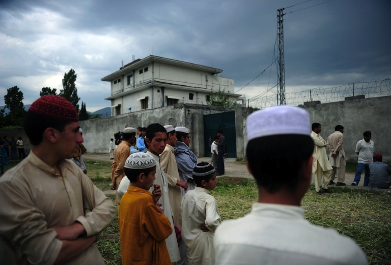 <p>Pakistani seminary students gather in front of the final hiding place of Al Qaeda chief Osama bin Laden in Abbottabad on May 5, 2011.</p>