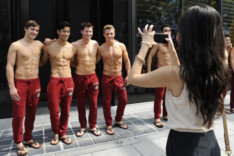 <p>Abercrombie &amp; Fitch models pose outside the A&amp;F store in Knightsbridge, a shopping mall in Singapore, on December 9, 2011.</p>