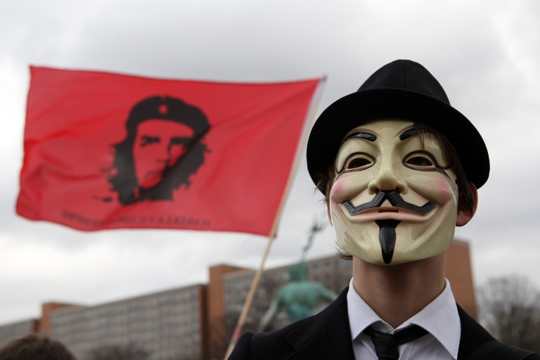 <p>An activist in a Guy Fawkes mask protests during a demonstration against the Anti-Counterfeiting Trade Agreement (ACTA) on February 25, 2012 in Berlin, Germany.</p>